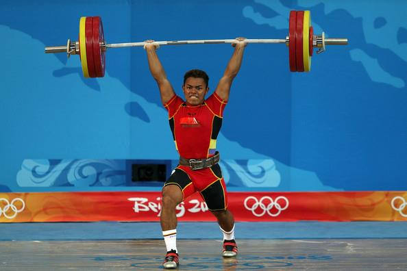 Weightlifter in lunge position post jump