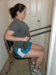 Scapular retraction with theraband in sitting + Chin tuck + TA
