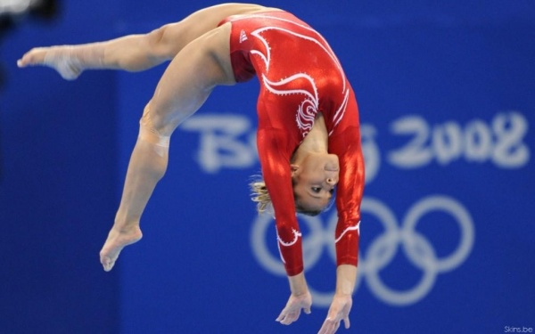 Gymnast performing on the beam