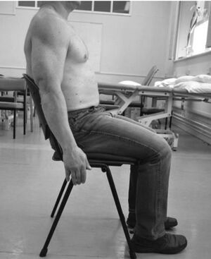 Patient Position to assess glenohumeral subluxation via fingerbreadth palpation method
